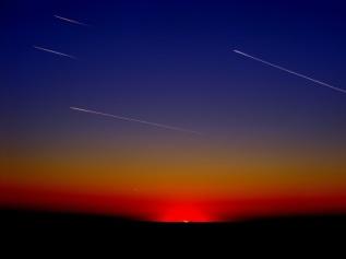 meteors across sunset