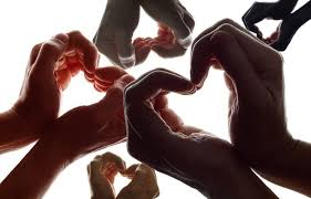 5 pairs of hands making hearts.